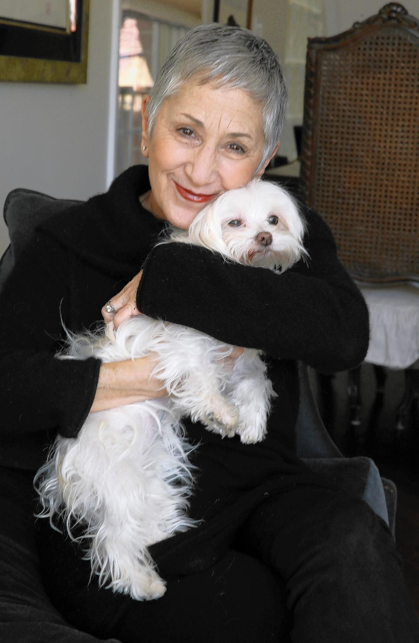 Cari Meyers holds her dog, Millie. Meyers' Puppy Mill Project scored a victory with the Chicago City Council's passage of a bill to ban commercially bred dogs, cats and rabbits.