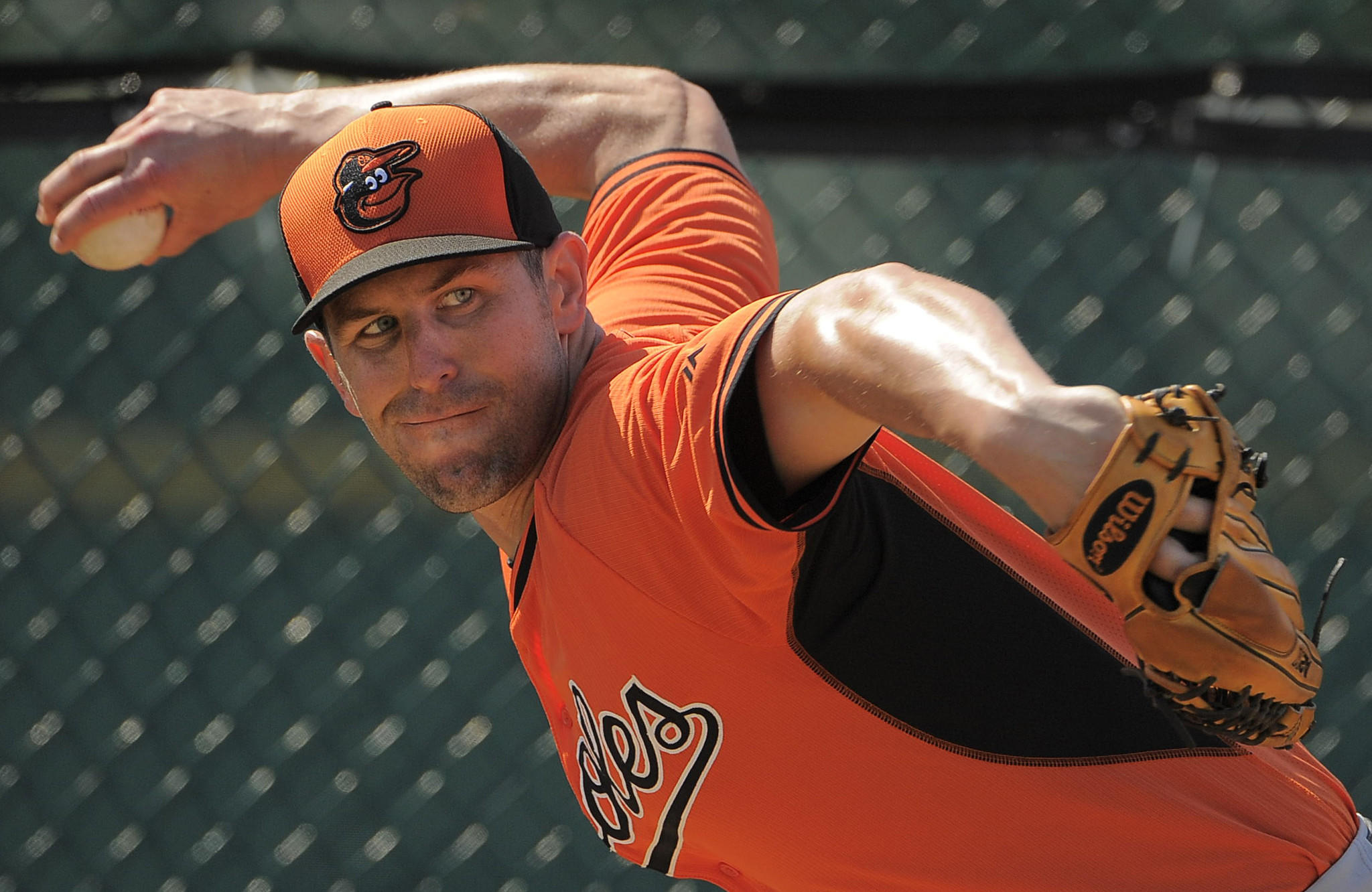 Orioles relief pitcher Darren O'Day winds to throw, warming up during workouts at the Orioles' spring training facility.