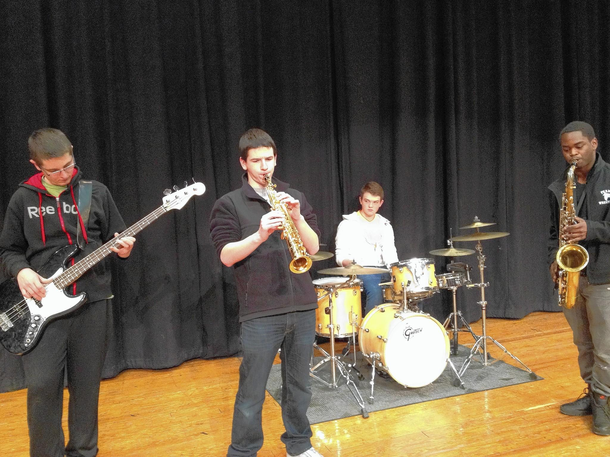 Enrico Fermi High School students Jack Duga, Nick Ryder, Josh Jamison and Courtland Huckabee are all part of Fermi's jazz component. Here they practice together for a talent show at the school.