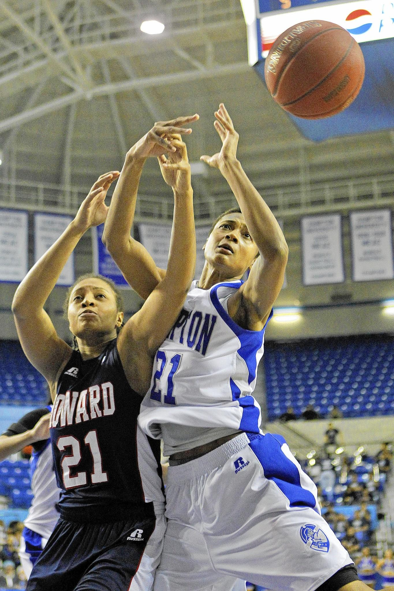 Hampton University's Alyssa Bennett, right, and Howard University's Cheyenne Brown, battle for a rebound during Saturday's game.