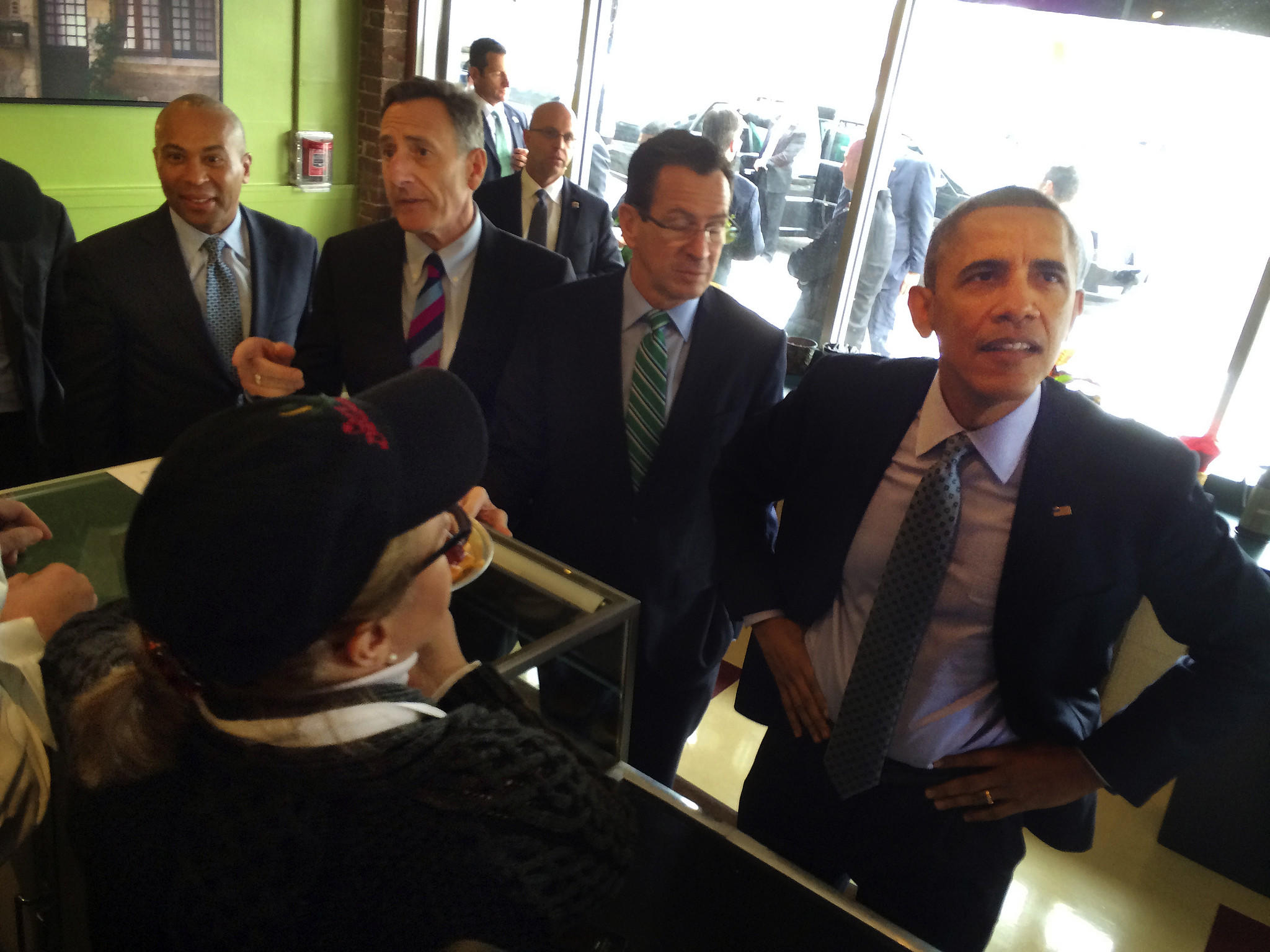 President Barack Obama, accompanied by Massachusetts Gov. Deval Patrick, Vermont Gov. Peter Shumlin and Gov. Dannel P. Malloy, looks to order lunch Wednesday at Cafe Beauregard in New Britain.
