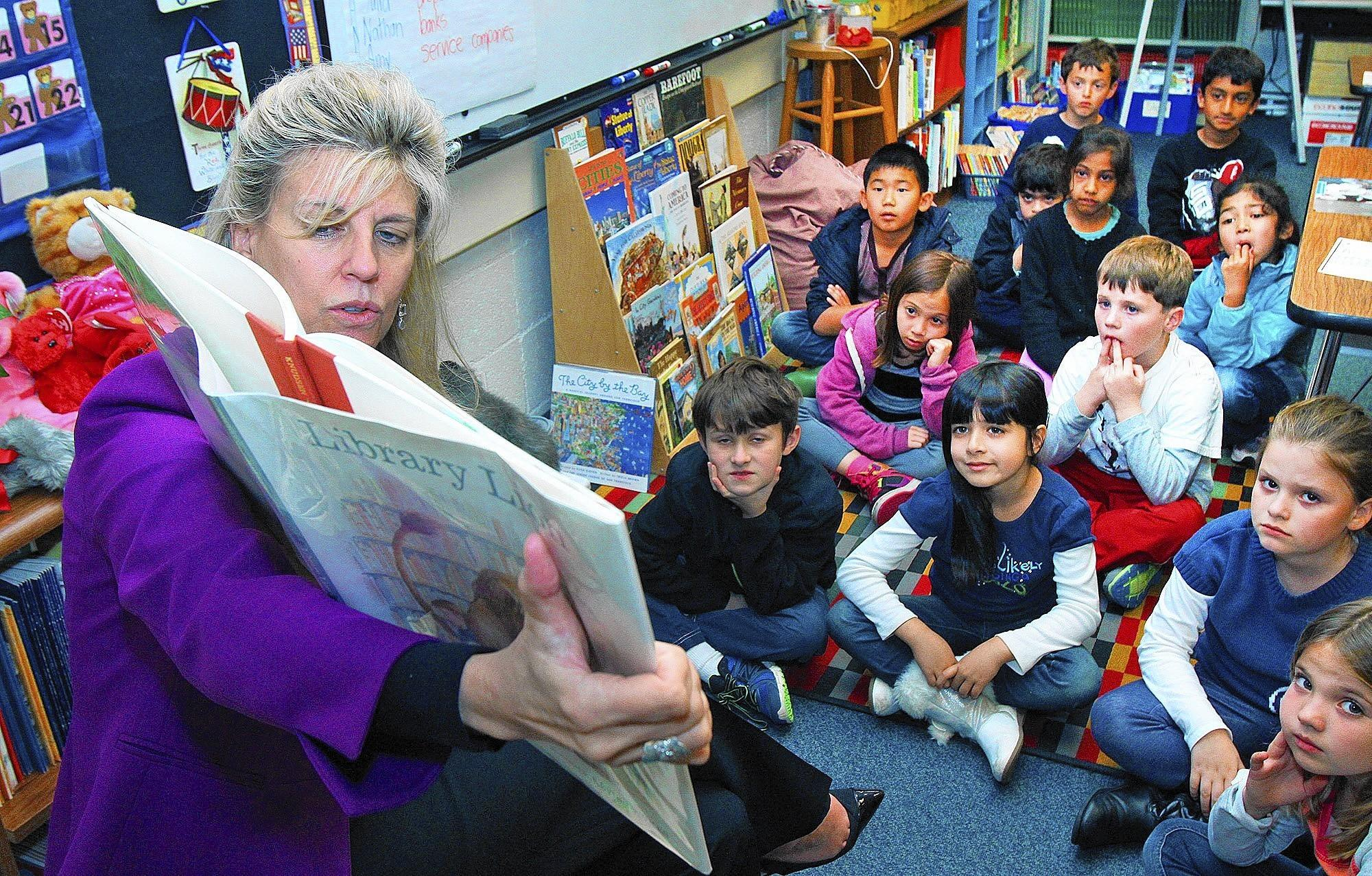 "La Cañada School District Superintendent Wendy Sinnette reads ""Library Lion"" to Mrs. Pruden's third grade class as part of the Dr. Seuss Read Across America at La Cañada Elementary on Friday, Feb. 28, 2014."