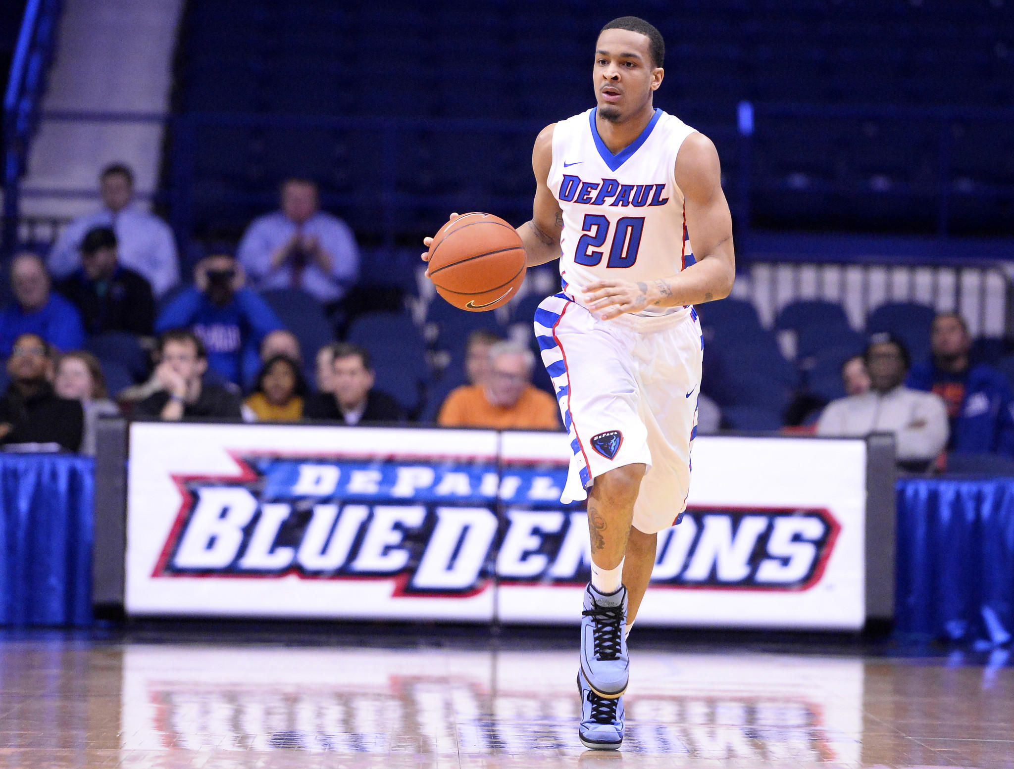 DePaul's Brandon Young dribbles the ball against Georgetown during the first half.