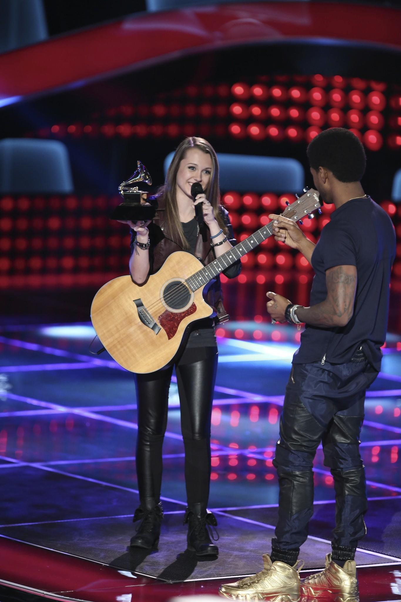"During the blind auditions of ""The Voice,"" Bria Kelly of Smithfield, held one of Usher's Grammy Awards."