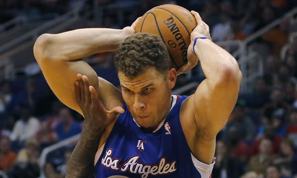 Clippers power forward Blake Griffin controls the ball against the Suns in Phoenix.