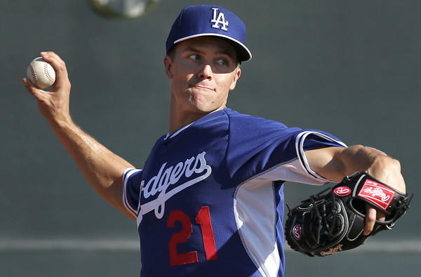 Dodgers starting pitcher Zack Greinke throws during a spring training practice last month.