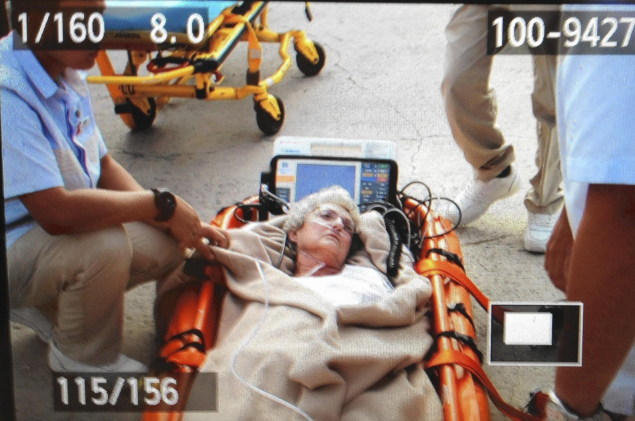 Elaine Smith, 73, is taken off the Carnival Liberty cruise ship in Grand Cayman after she fell ill with a life-threatening ulcer, Feb. 27, 2014, and was saved by transfusions from some of the estimated 150 passengers and crew who volunteered to give blood.