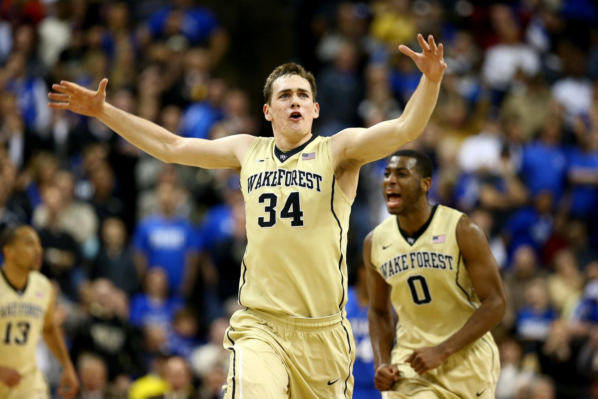 Wake Forest's Tyler Cavanaugh reacts after hitting a shot with teammate Codi Miller-McIntyre.