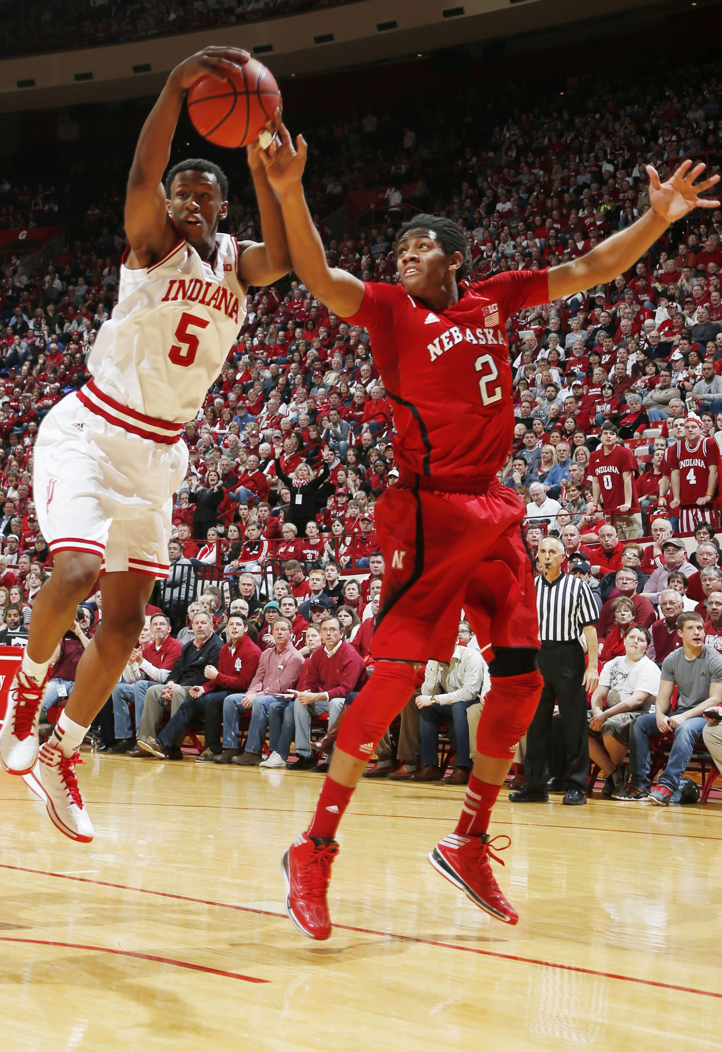 Indiana's Troy Williams grabs a rebound against Nebraska's David Rivers at Assembly Hall.