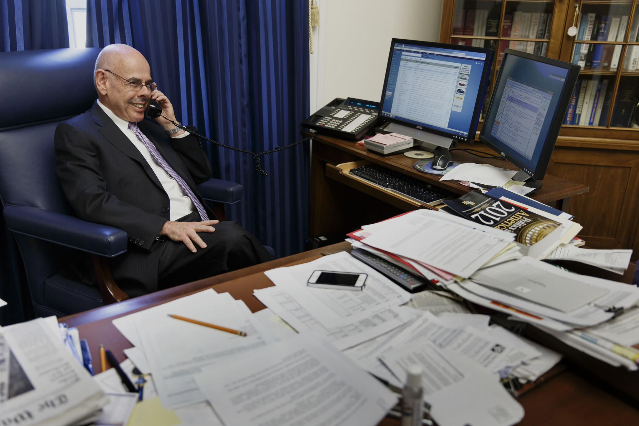 Rep. Henry Waxman (D-Calif.) fields a flurry of phone calls in his Capitol Hill office in Washington after he announced he would retire after 40 years in the House of Representatives.