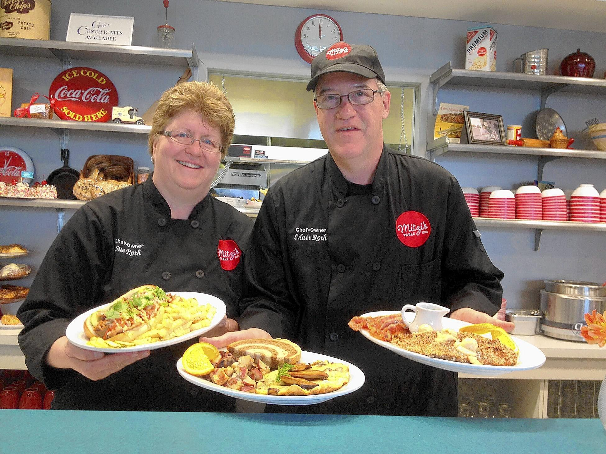 Chefs Susan and Matt Roth, owners of Mitzi's Table in Bethlehem, with their banh mi sandwich, best oatmeal crusted French toast and Primordia Farms wild mushroom frittata.