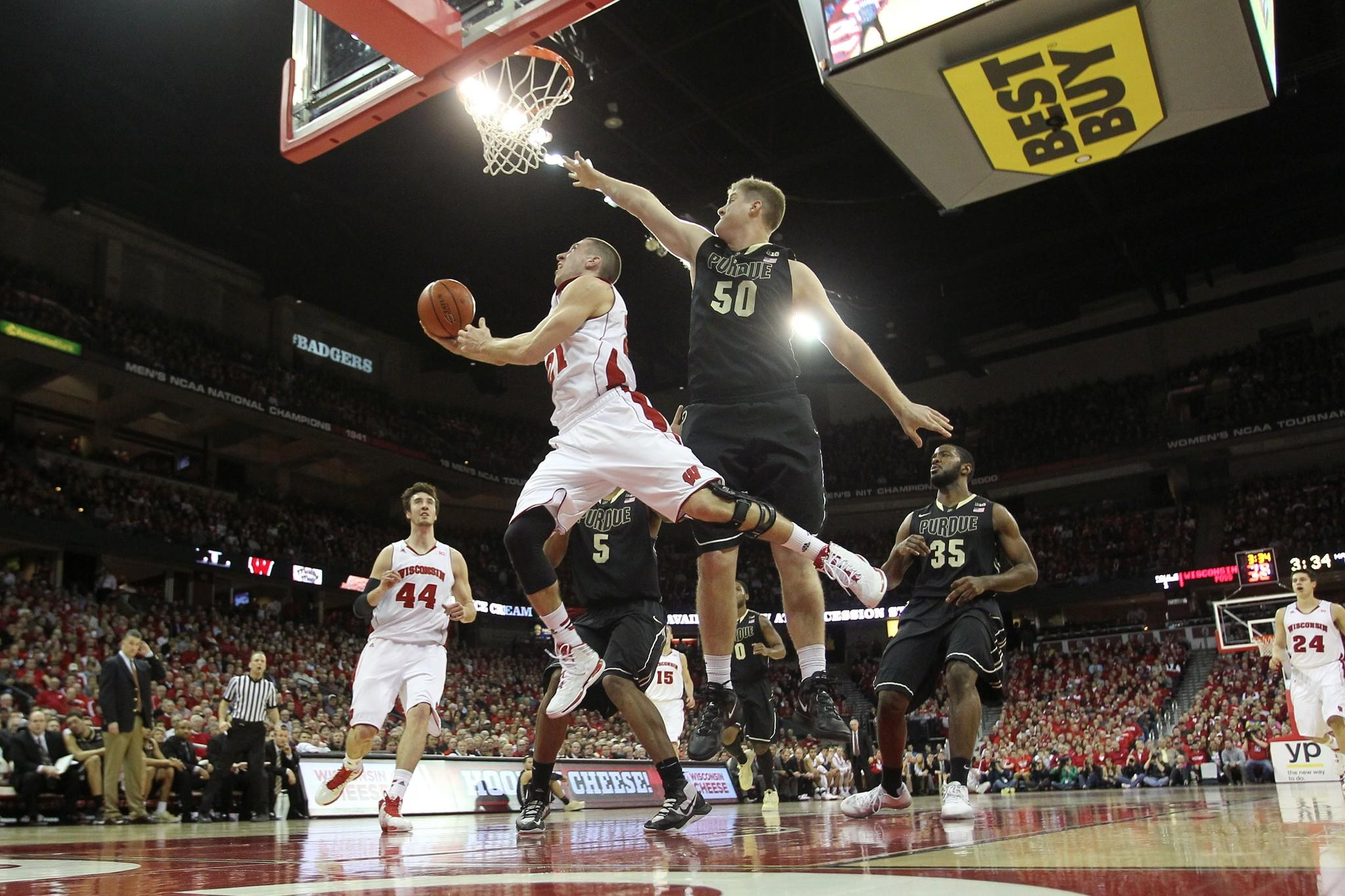 Wisconsin's Josh Gasser drives to the hoop during the first half of play against Purdue.