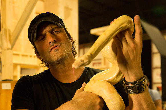 "Robert Rodriguez with one of the slithery stars of ""From Dusk Till Dawn: The Series."""