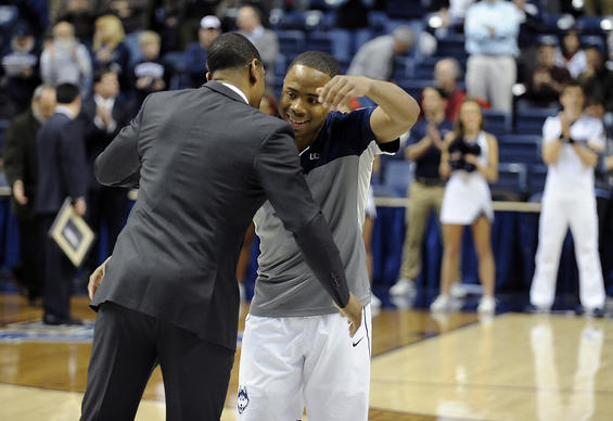 UConn guard Tor Watts (25) hugs Connecticut Huskies head coach Kevin Ollie during Senior Night at Gampel Pavilion in Storrs Wednesday night.