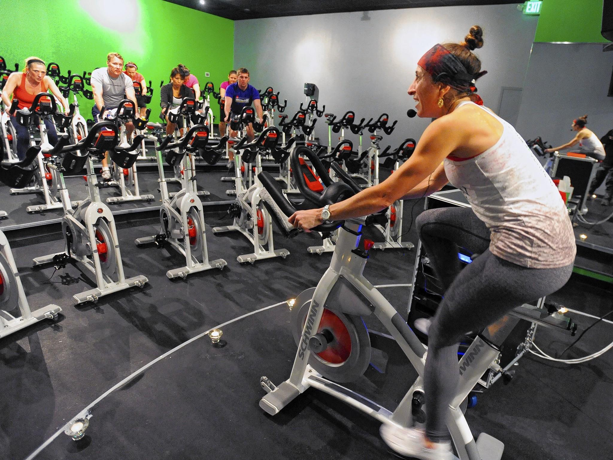 Esther Collinetti, right, of REV Cycle Studio, leads the REV60 Zen class, which combines spinning with yoga.