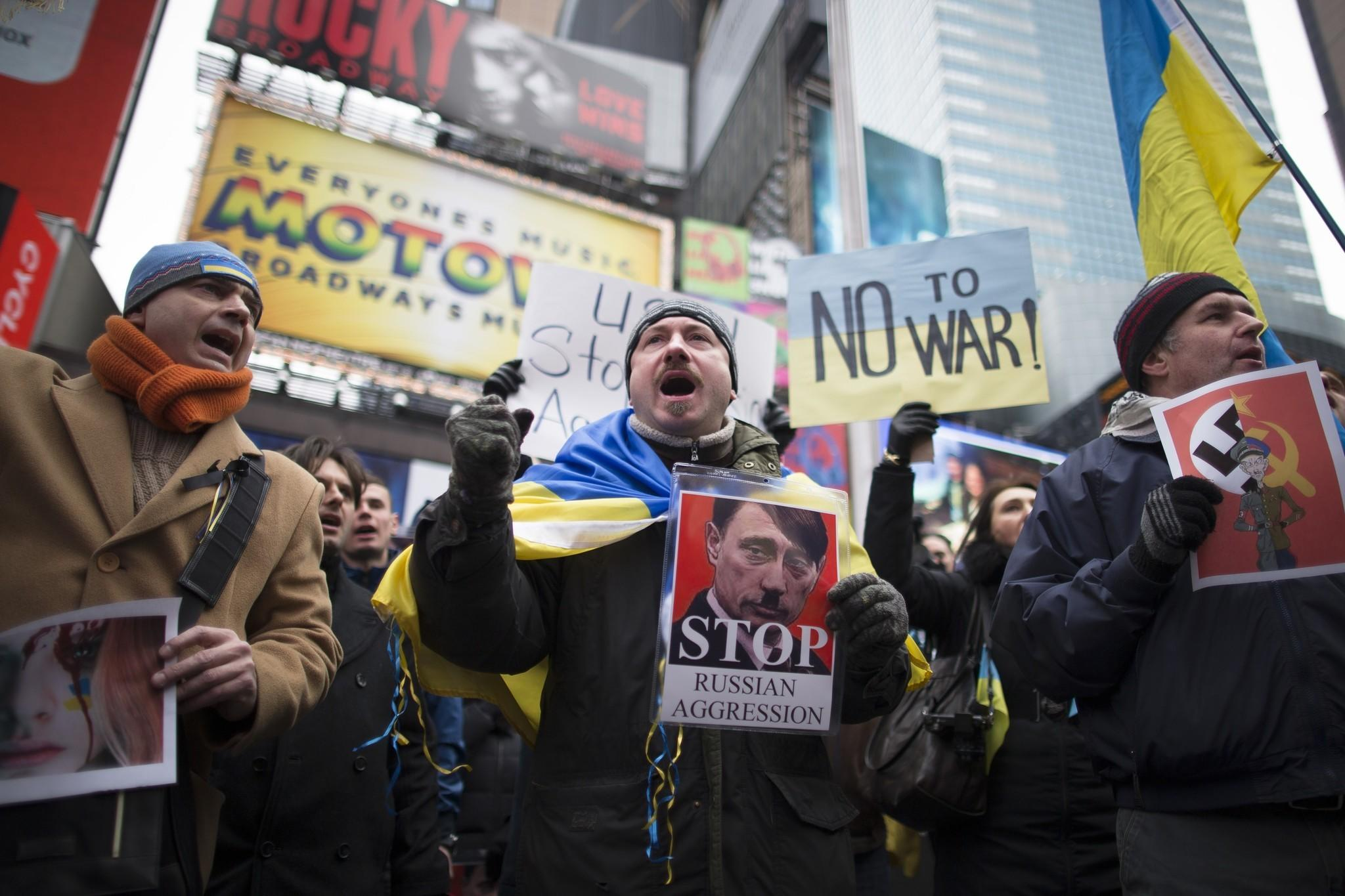 Protesters in New York's Times Square take part in a demonstration against Russian military actions in Ukraine.