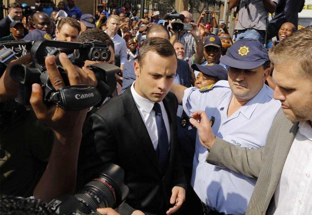 Oscar Pistorius leaves court.