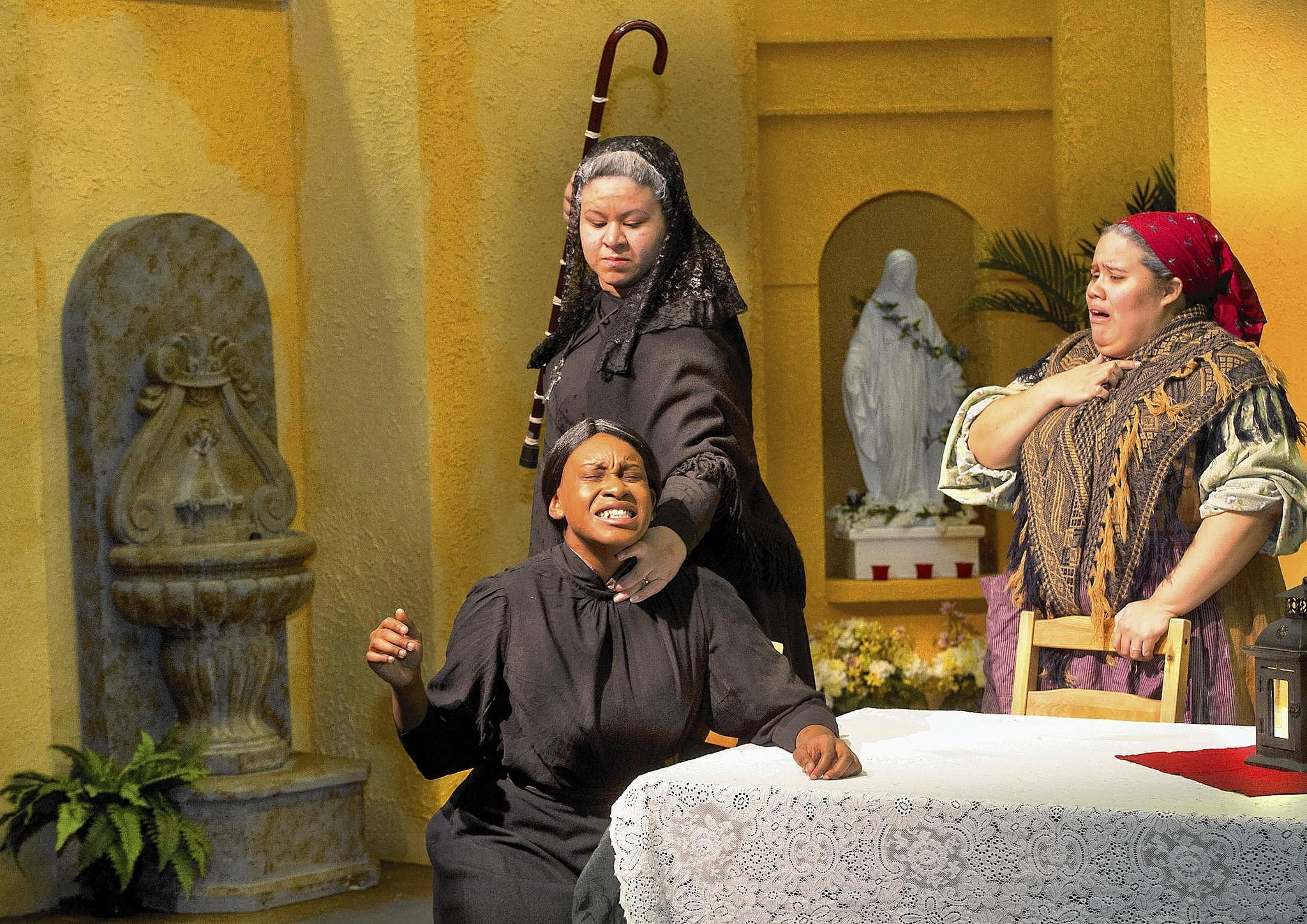 "Chloe Cole (front), Jazmin Sanchez (rear, left), and Jennifer Torres in ""The House of Bernarda Alba"" at Northampton Community College."