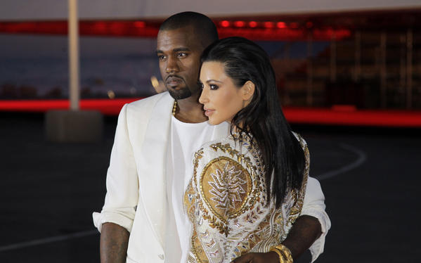 Kanye West and Kim Kardashian reportedly plan to marry in May. Above, the couple at the Cannes film festival in 2012.