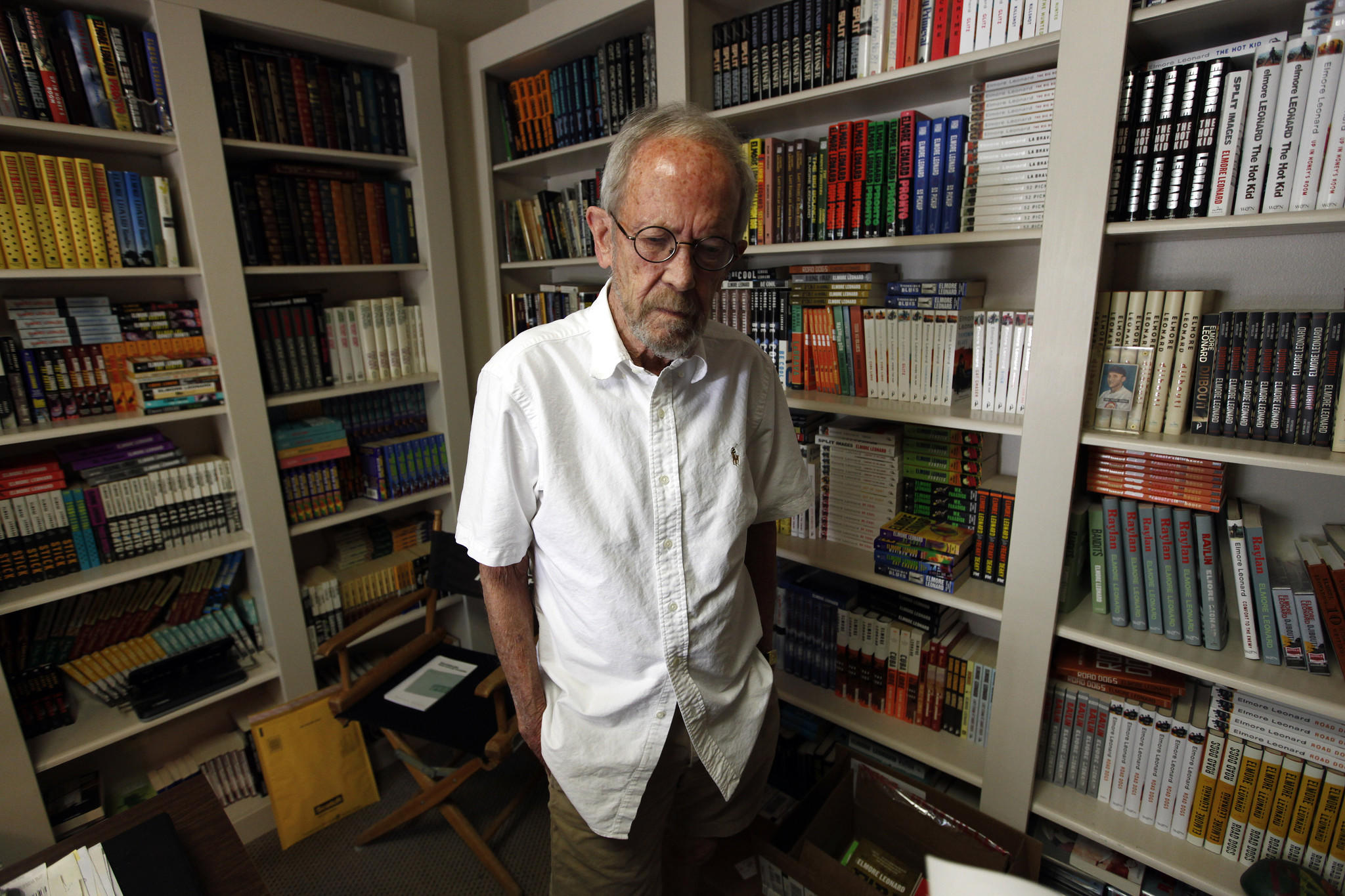 Elmore Leonard, at home in 2012, died in 2013. Books and furniture from his home are being sold at an estate sale.