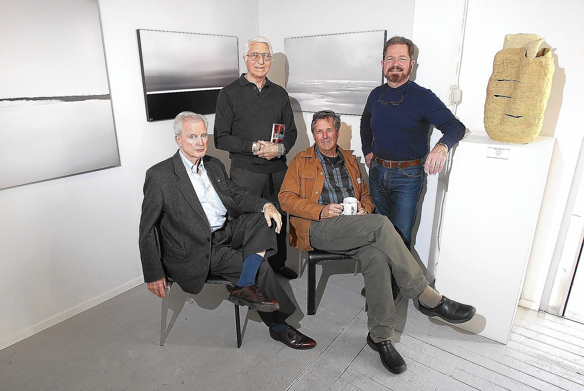 Sculptor Paul Woodward, photographers Tom Lamb and Hans Rindfleisch and gallery owner Ludo Leideritz, left to right, present the fourth installment of the Artist Spotlight series from March 10 to April 6 at the Forest and Ocean Gallery.