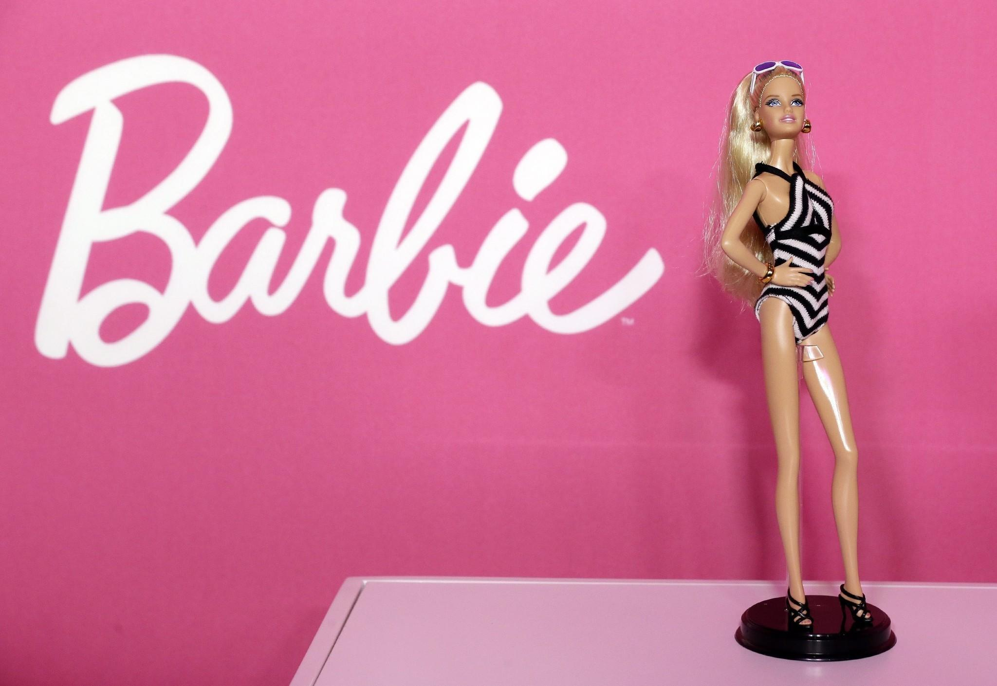 Less than a month after Barbie courted controversy for appearing in the pages of Sports Illustrated's swimsuit issue, advocacy groups are criticizing a partnership between the Girl Scouts and Mattel, the maker of the toy doll.