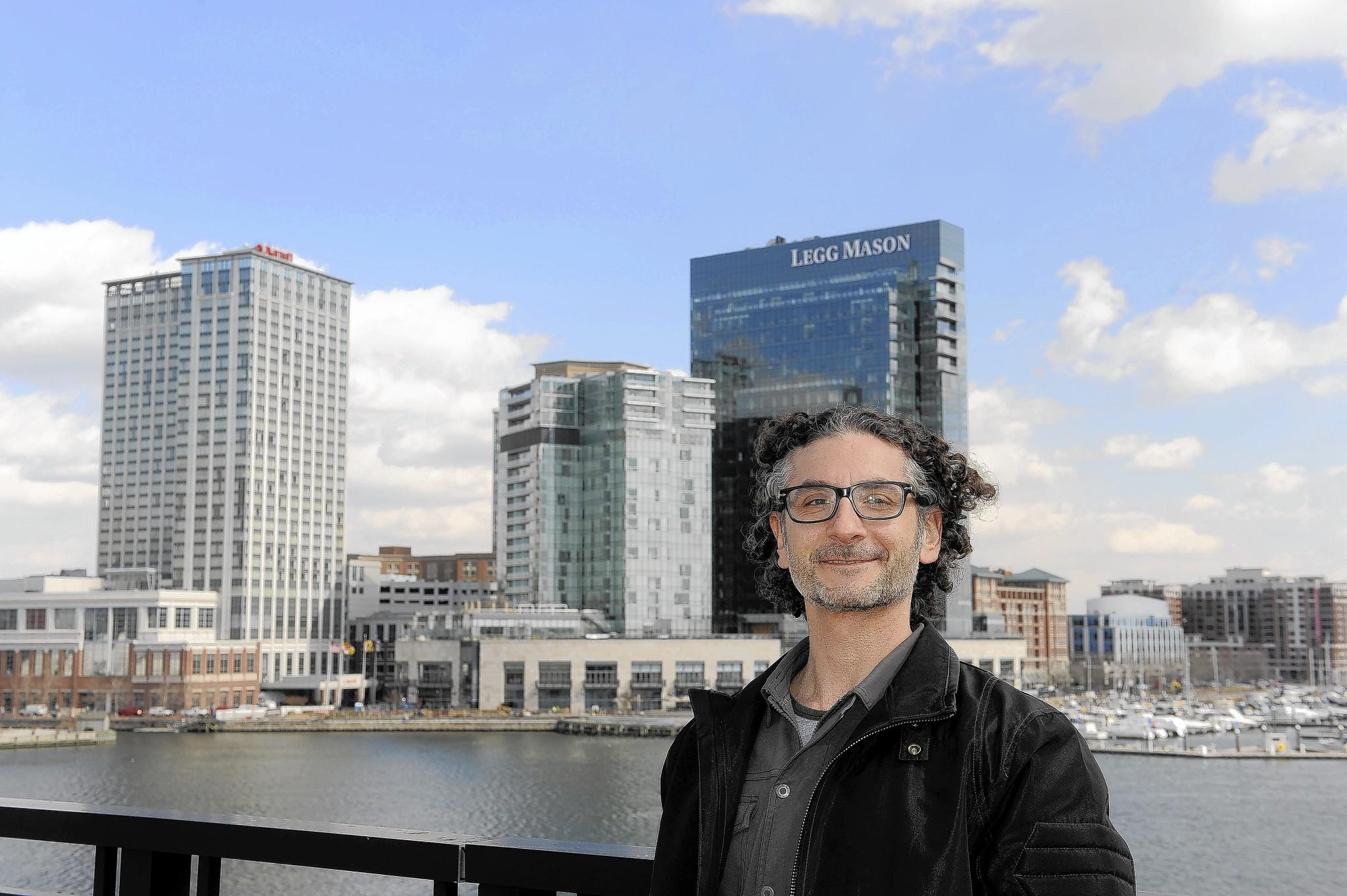 Greg Cangialosi stands on his patio at the Ritz Carlton Residences in Baltimore.