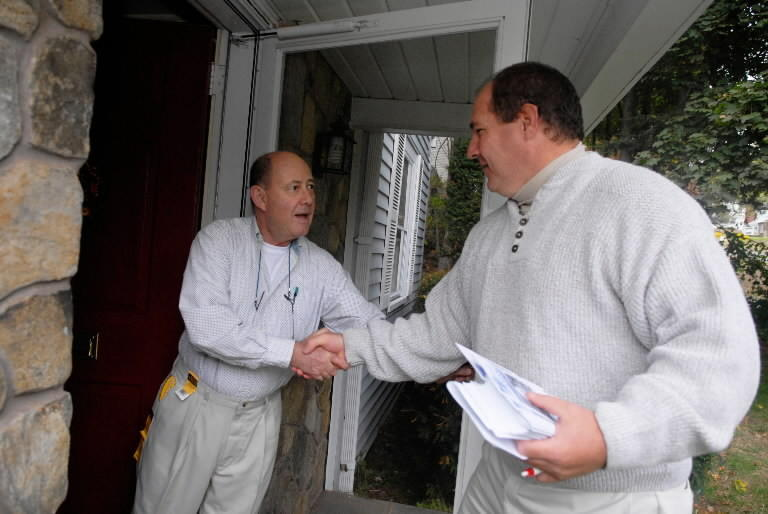Howard Bergman, left, greets John Topping, who was a successful Democratic candidate for board of directors in 2007.