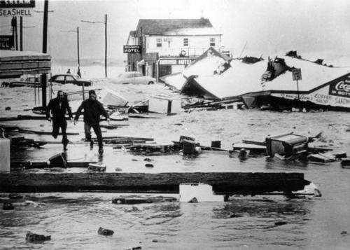 Buckroe Beach was particularly hard hit by the Great Ash Wednesday Storm of March 1962, with many of the buildings in the resort strip damaged if not destroyed. Here two men scurry for safety as the water surges over the seawall.