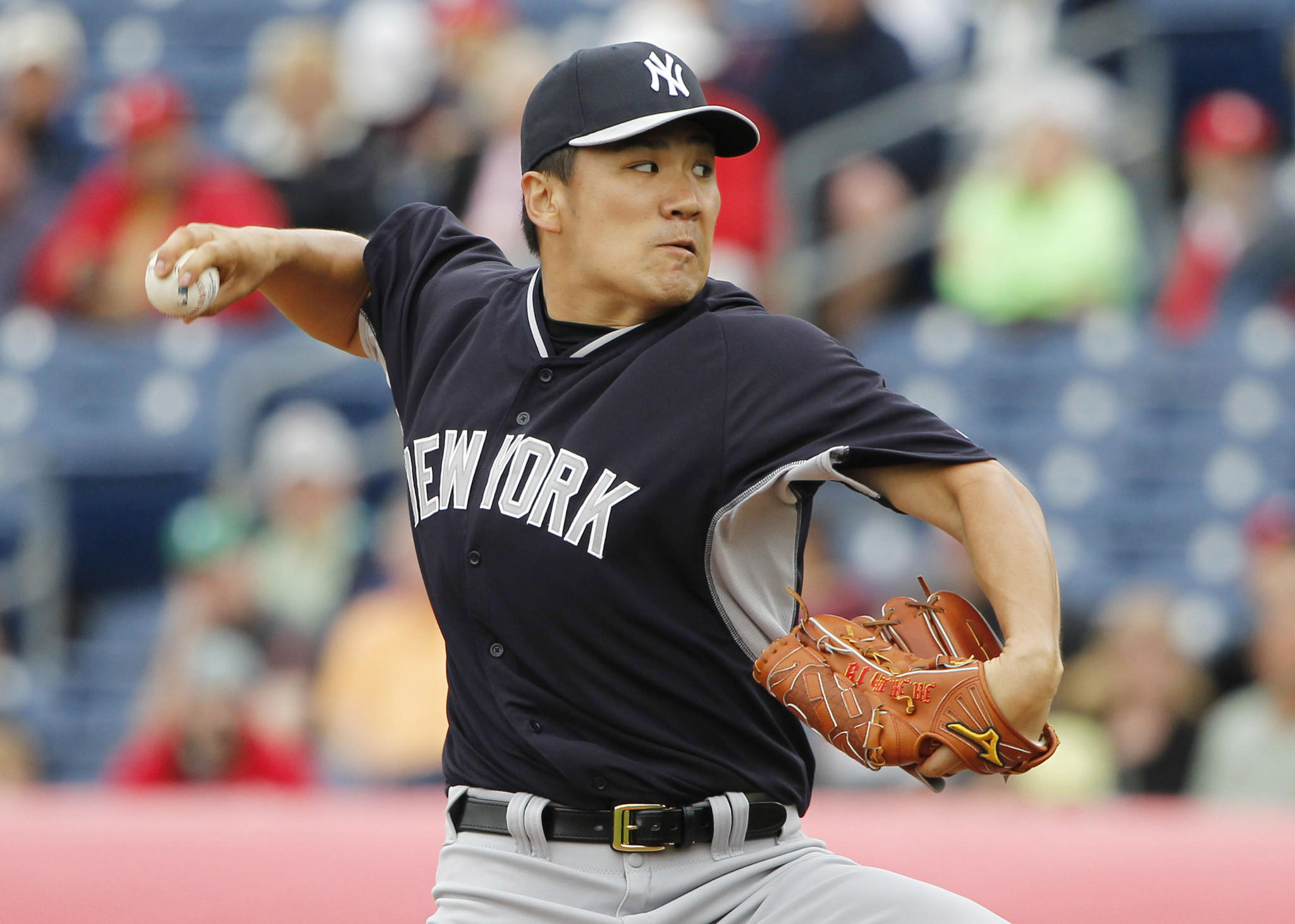 New York Yankees starter Masahiro Tanaka throws a pitch during the first inning against the Philadelphia Phillies.
