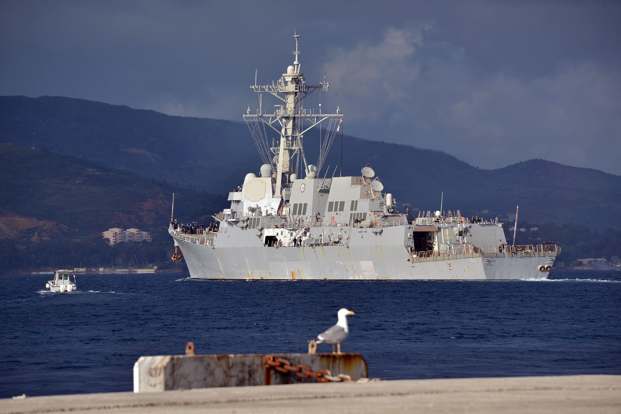 The guided-missile destroyer USS Truxtun (DDG 103) departs the Marathi NATO pier facility following a scheduled port visit to the Greek island of Crete. Truxtun is deployed in support of maritime security operations and theater security cooperation efforts in the U.S. 6th Fleet area of responsibility. (U.S. Navy photo by Paul Farley/Released)