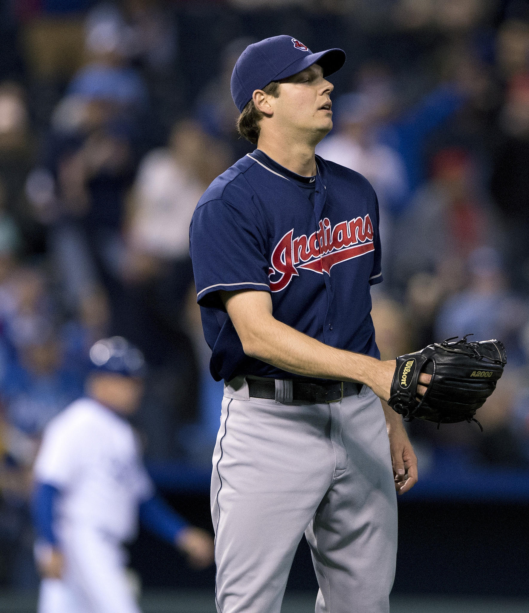 Cleveland Indians relief pitcher Rich Hill looks away after walking the Kansas City Royals' Eric Hosmer with the bases loaded to score Alex Gordon in the seventh inning in a game last April.