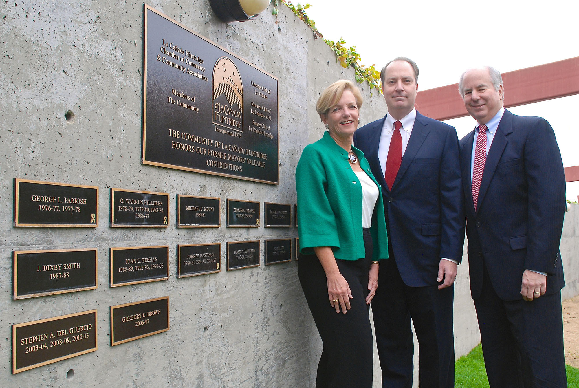La Cañada Flintridge Mayor Laura Olhasso joins two former mayors of the city, Steve Del Guercio and Greg Brown, at Memorial Park on March 3 for the unveiling of their respective plaques in Mayors' Discovery Park.