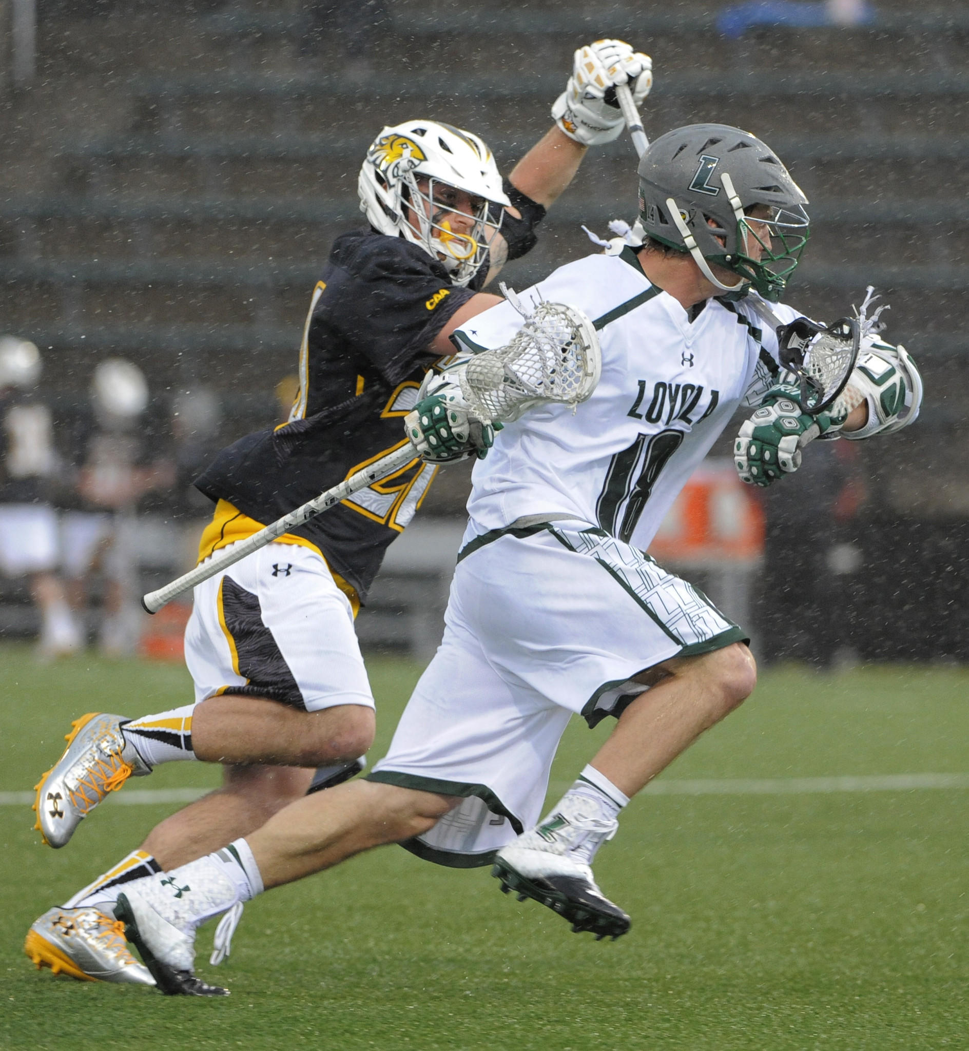 Loyola's Nikko Pontrello tries to get by Towson's Mike Lowe in the first half in February.