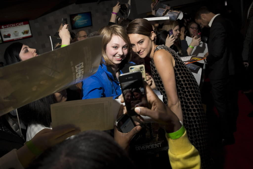 "Actress Shailene Woodley (right) poses with fan Ali Walder (left) of Milwaukee, Wis. at the Chicago premiere of ""Divergent"" at Showplace Icon Theater March 4, 2014."