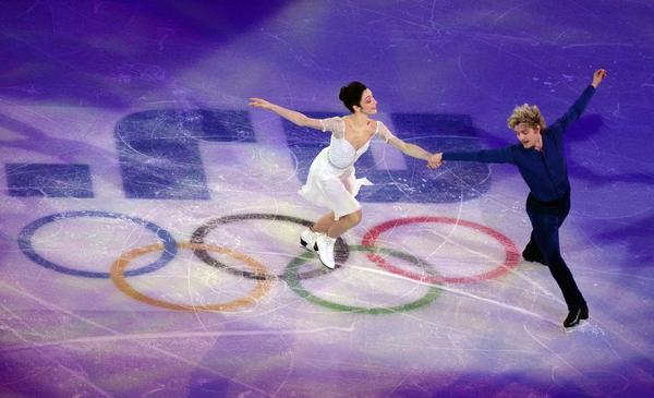 Charlie White and Meryl Davis perform at the Figure Skating Exhibition Gala at the Iceberg Skating Palace during the Sochi Winter Olympics.