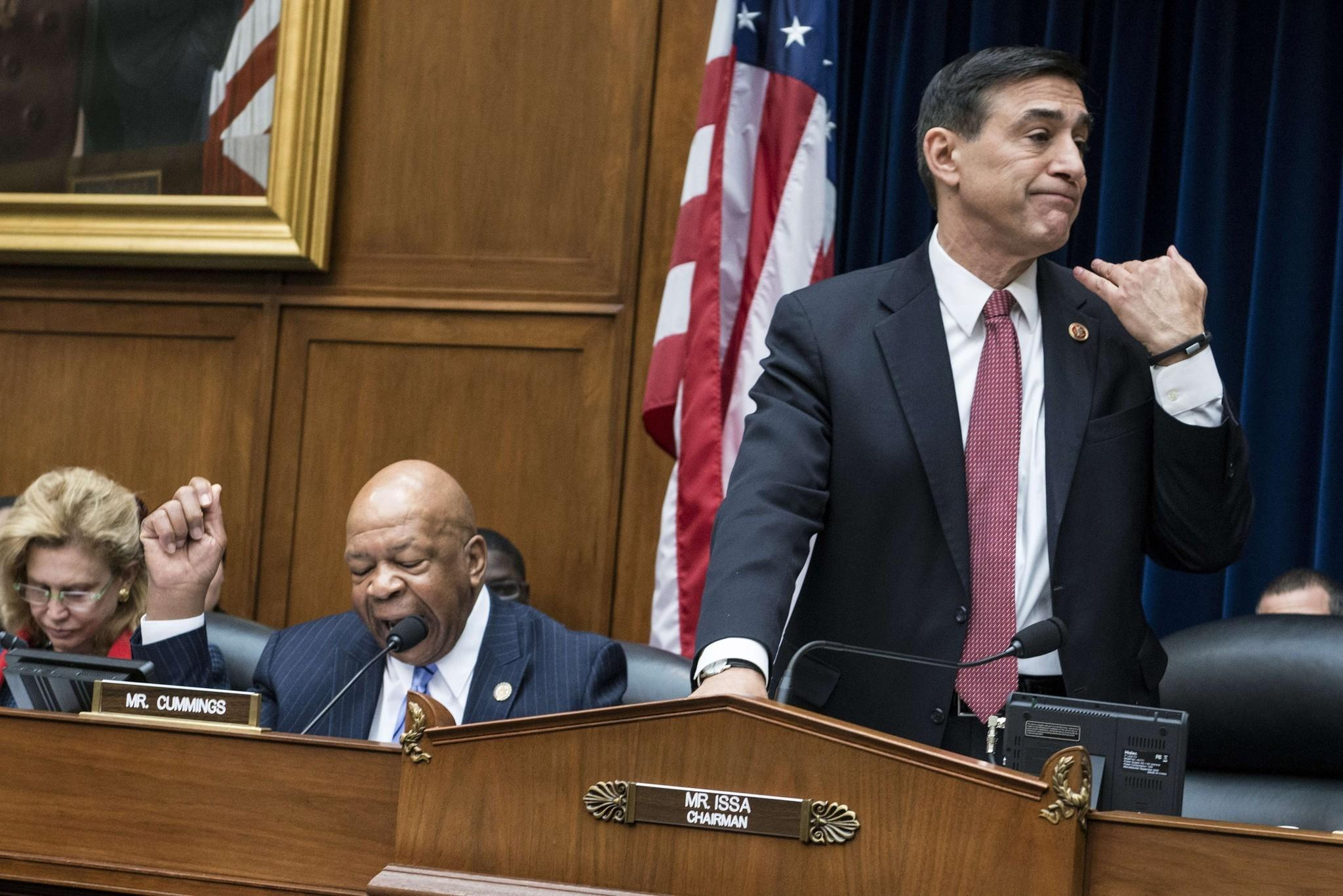 Rep. Darrell Issa motions to Republican staff members to cut off the microphone of Rep. Elijah E. Cummings, left, during a hearing of the House Oversight and Government Reform Committee on Wednesday.