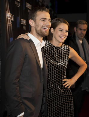 """Divergent"" co-stars Theo James (left) and Shailene Woodley (right) attend the film's Chicago premiere March 4, 2014 at Showplace Icon Theater."