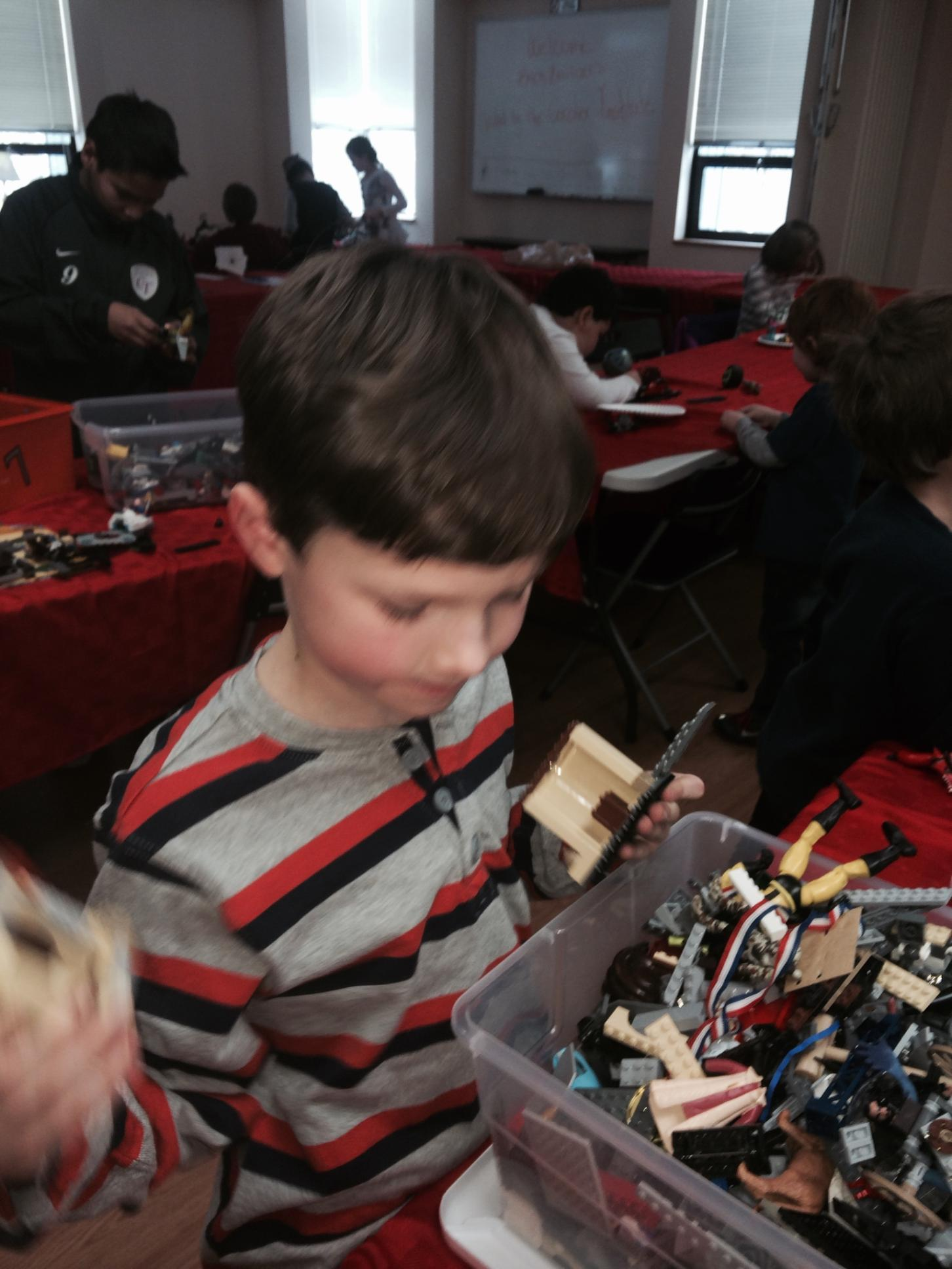 Thomas Cordier of Glastonbury carefully selects which Legos to build with.