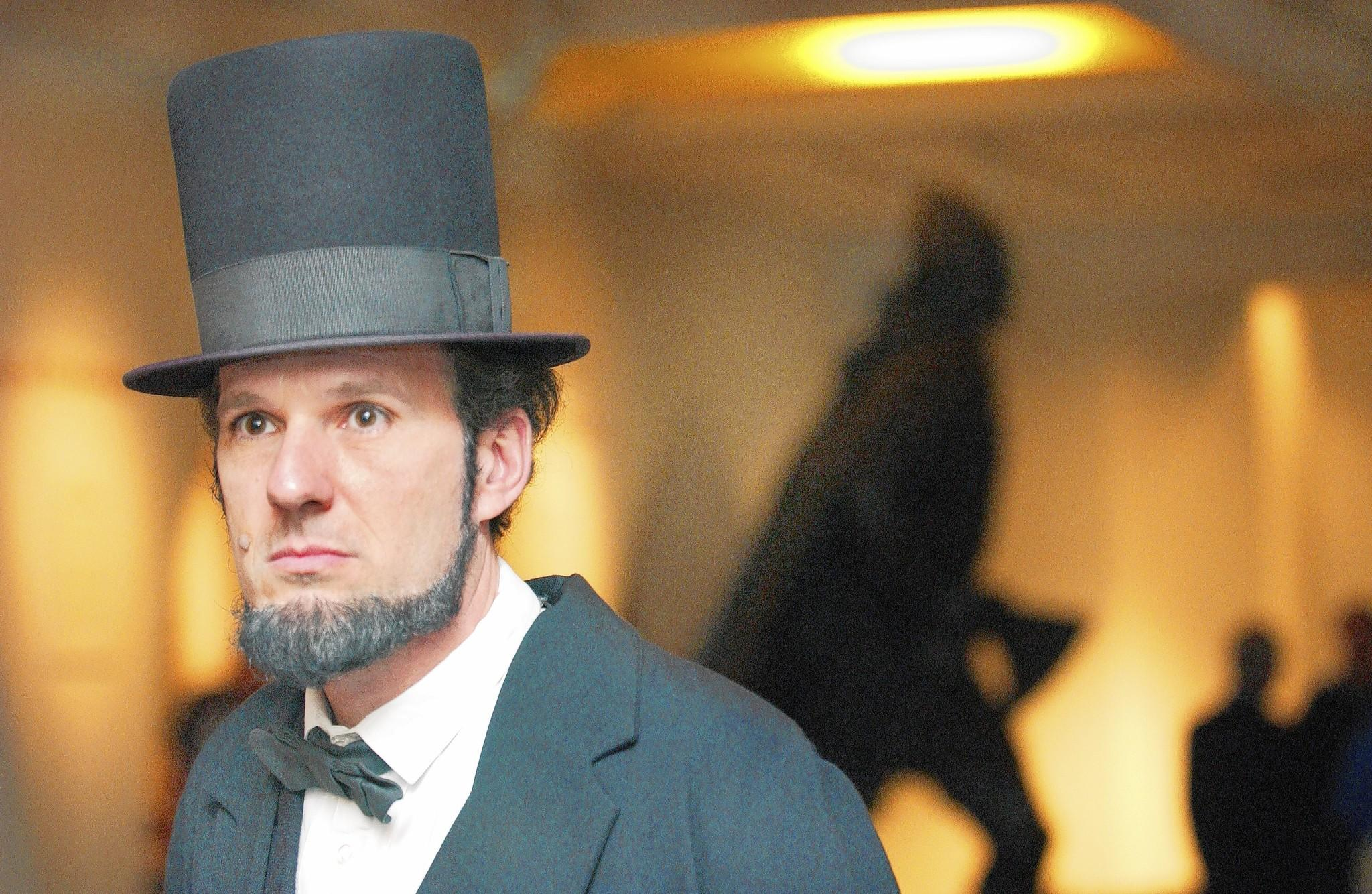 Abraham Lincoln historical interpreter George Buss portrayed the president during a previous Battle of Hampton Roads Weekend at The Mariners' Museum. Behind Buss is a sculpture of Leif Ericson.
