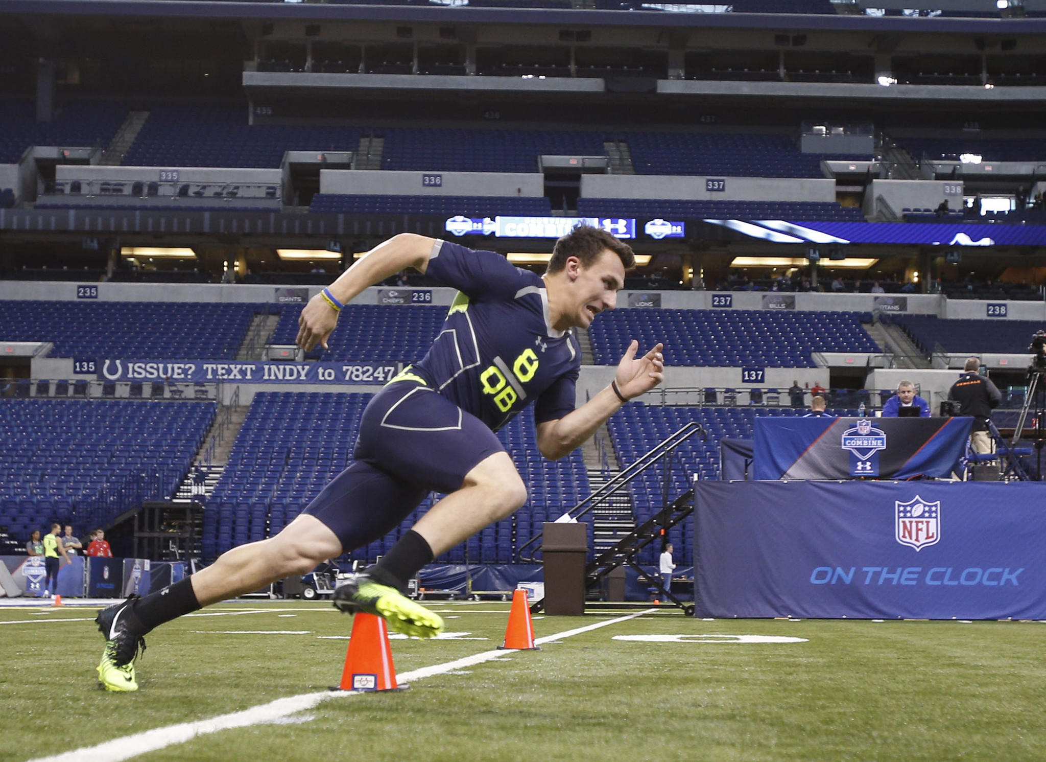 Quarterback Johnny Manziel runs the shuttle dash during the 2014 NFL combine at Lucas Oil Stadium.