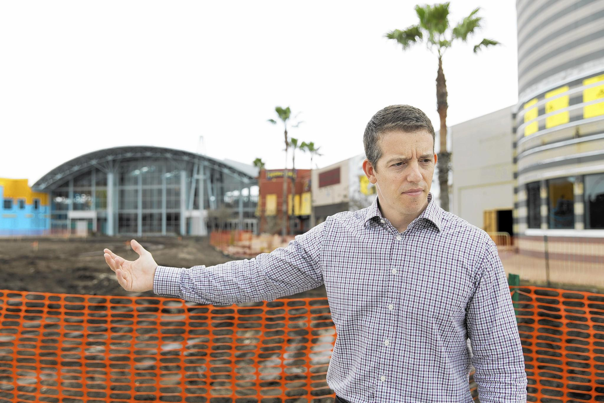 Scott Benjamin, vice president and general manager of Artegon Marketplace, gestures toward the ongoing construction at the entrance to the mall.