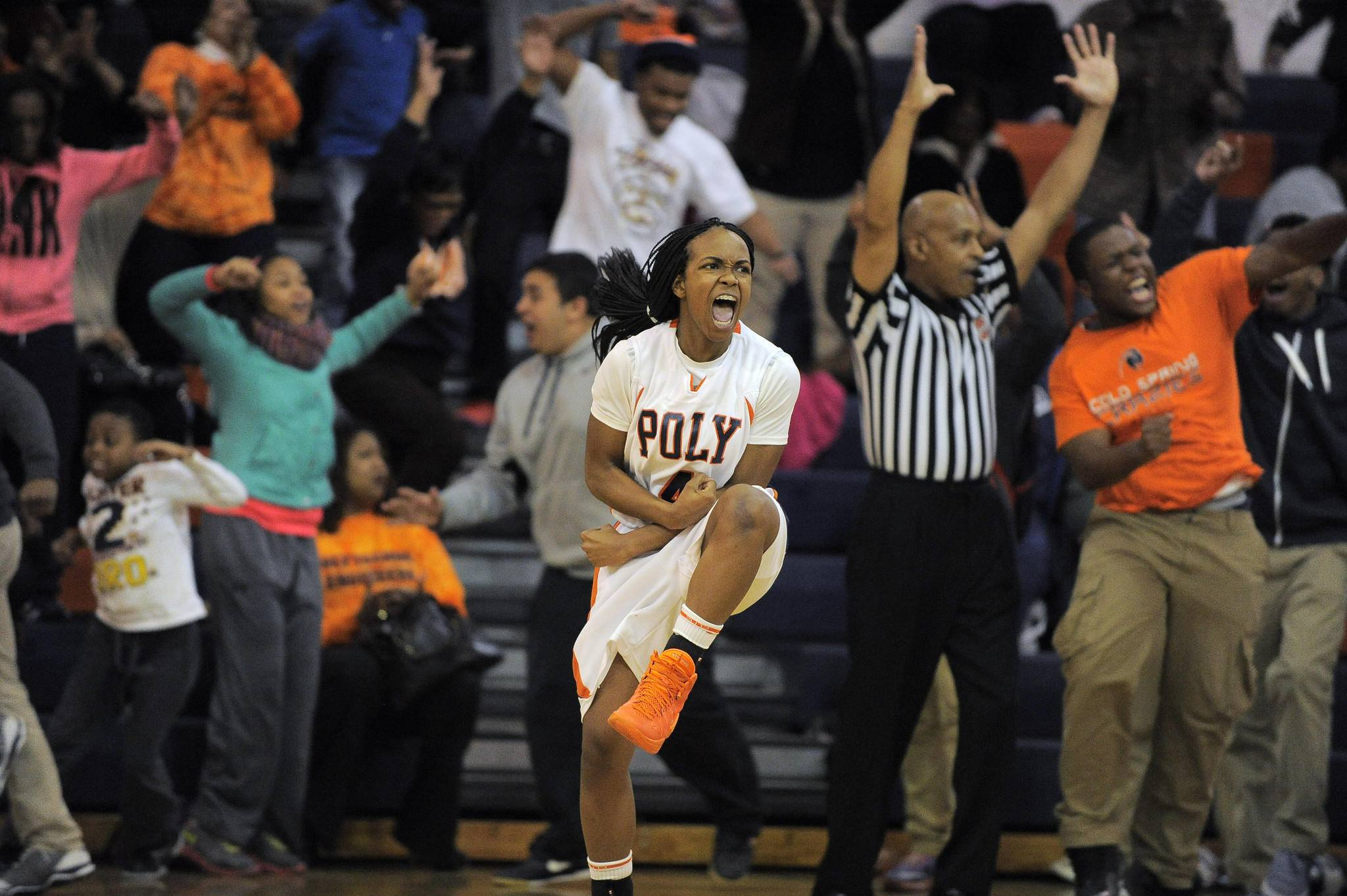 The home crowd goes wild behind Poly guard Jasmine Smith, who reacts after draining a buzzer-beating 3-point basket to tie City Knights during a Class 3A East Section I final.