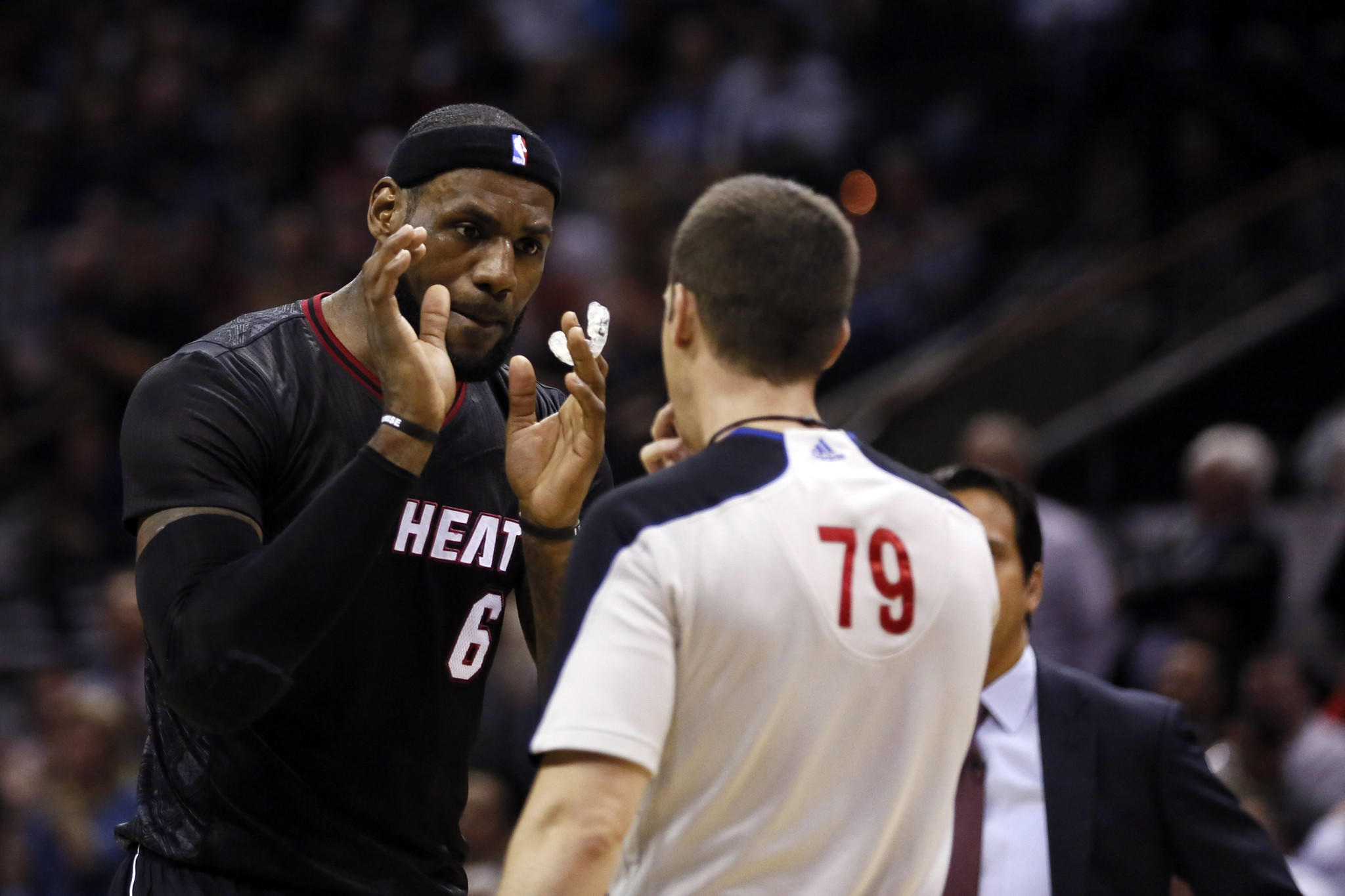 Mar 6, 2014; San Antonio, TX, USA; Miami Heat forward LeBron James (6) argues a call with referee Kevin Scott during the first half against the San Antonio Spurs at AT&T Center. Mandatory Credit: Soobum Im-USA TODAY Sports ORG XMIT: USATSI-141304