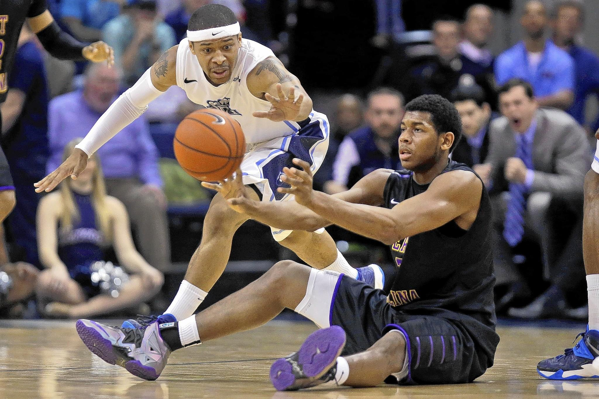 ODU's Jordan Baker, left, a former Hampton High star, competes for the ball with ECU's Brandan Stith on Thursday in Norfolk.