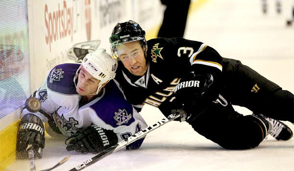 Staphane Robidas, who the Ducks aquired from the Dallas Stars because of his physical style of play, puts the Kings' Ryan Smith to the ice along the boards during a game on Jan. 17, 2011.