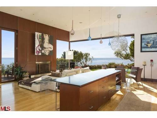 The home, listed at $3.995 million, has 180-degree coastline views.