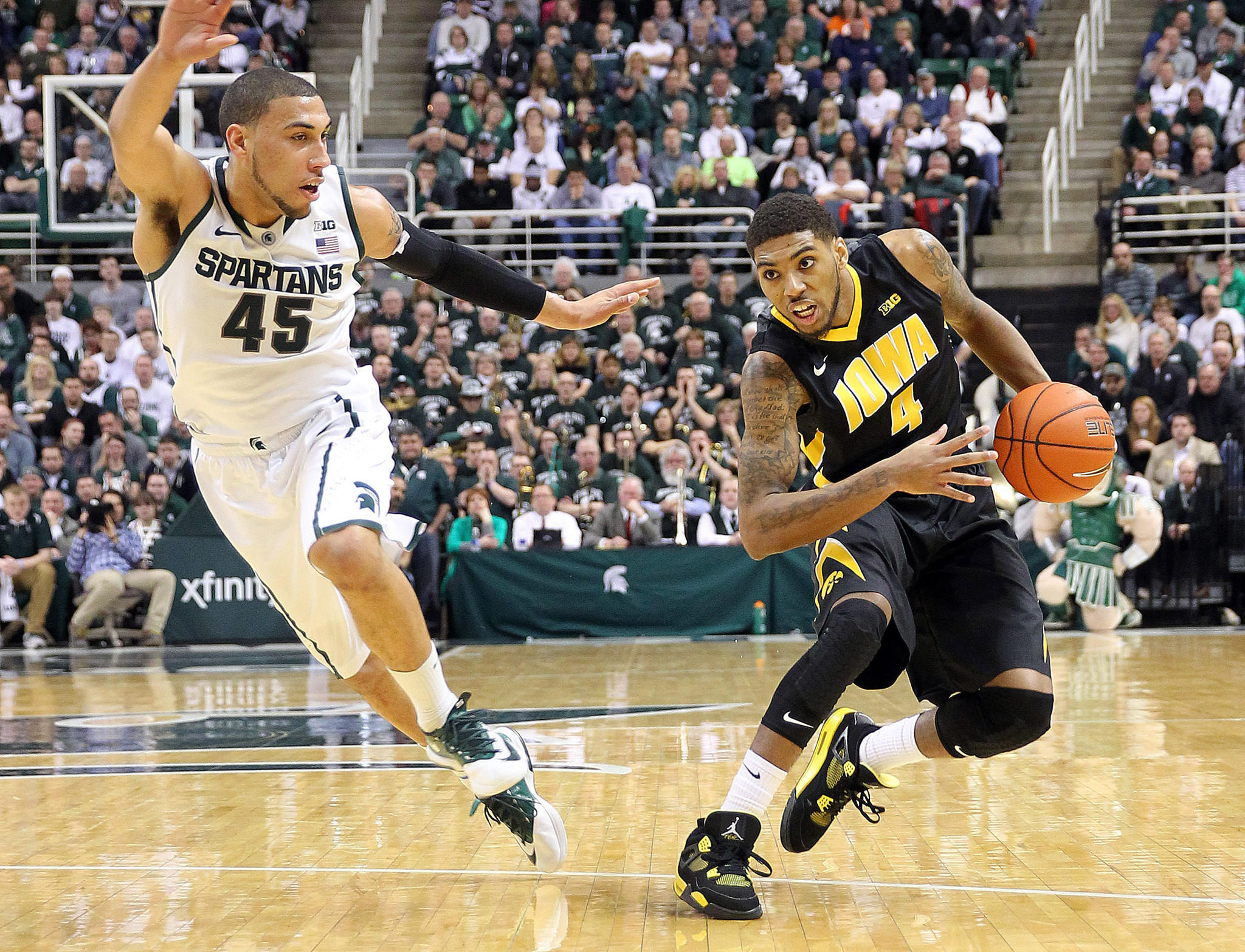 Iowa's Roy Devyn Marble drives to the basket against Michigan State's Denzel Valentine.