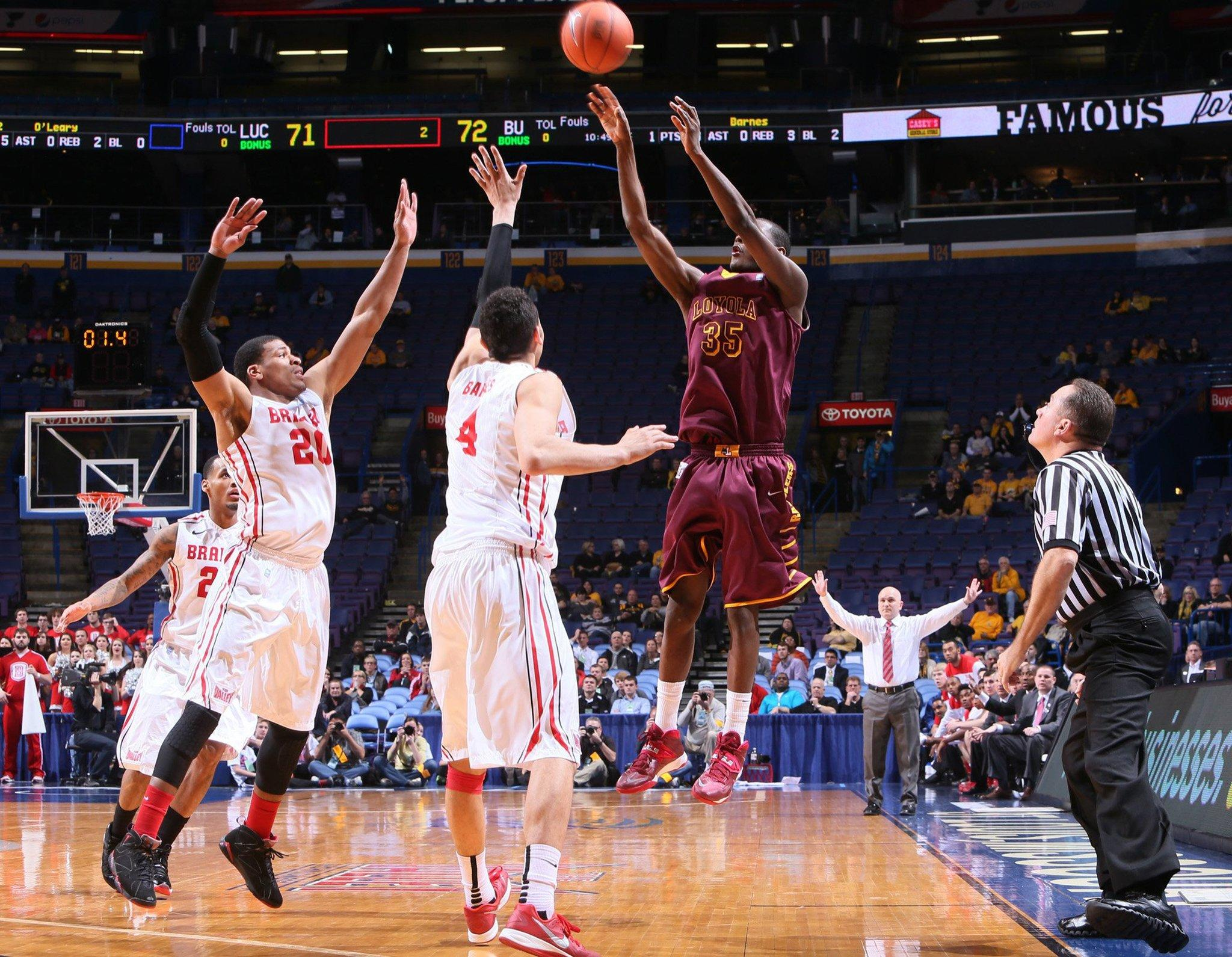 Loyola's Milton Doyle hits the game-winning 3-point shot with 1.4 seconds remaining against Bradley during the first round of the Missouri Valley tournament.