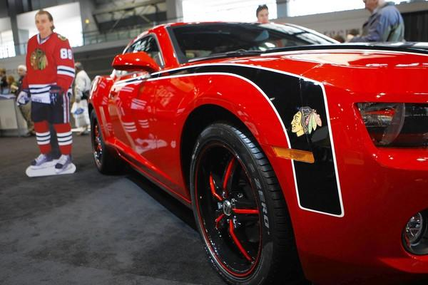 "A <a class=""taxInlineTagLink"" id=""ORSPT000163"" title=""Chicago Blackhawks"" href=""/topic/sports/ice-hockey/chicago-blackhawks-ORSPT000163.topic"">Chicago Blackhawks</a> themed Camaro is to be raffled off at the <a class=""taxInlineTagLink"" id=""EVFES0000003"" title=""Chicago Auto Show"" href=""/topic/economy-business-finance/chicago-auto-show-EVFES0000003.topic"">Chicago Auto Show</a>."